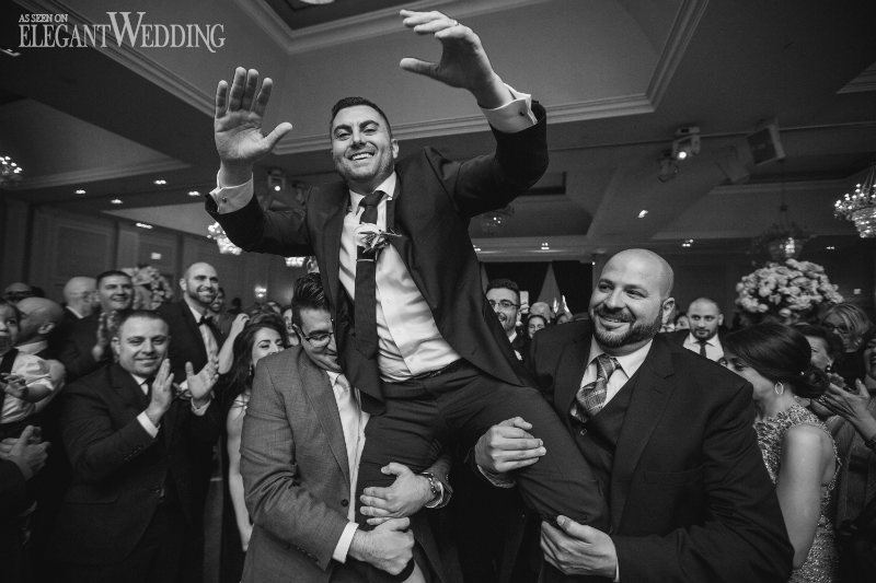 Groom Hoisted in the Air