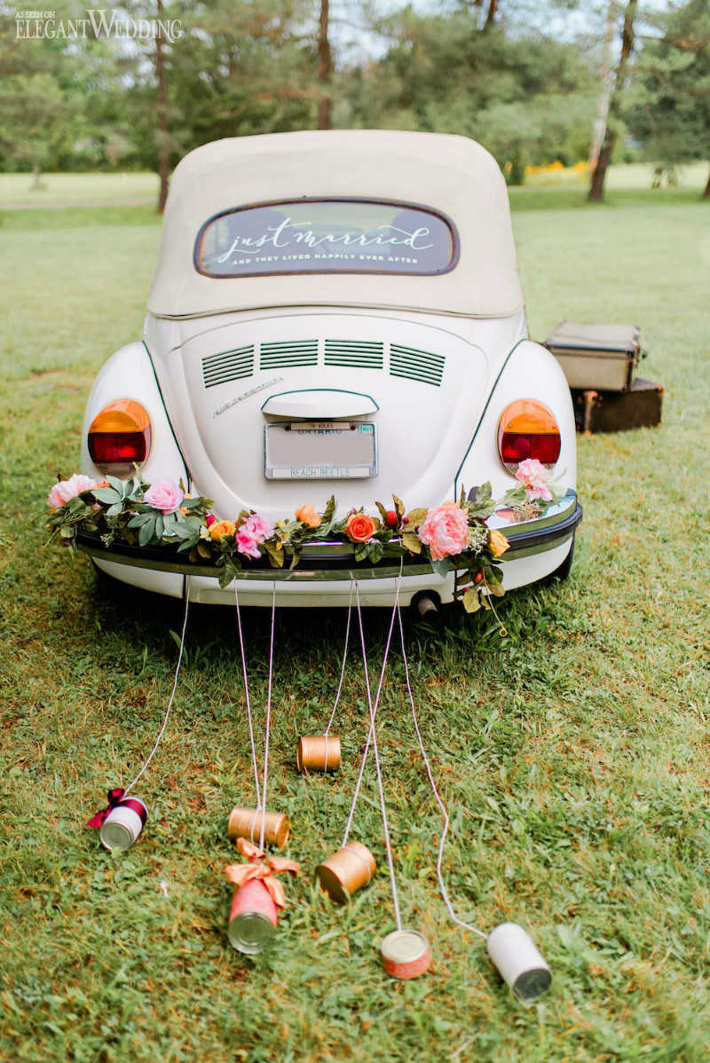 Just Married Car Flowers and Cans