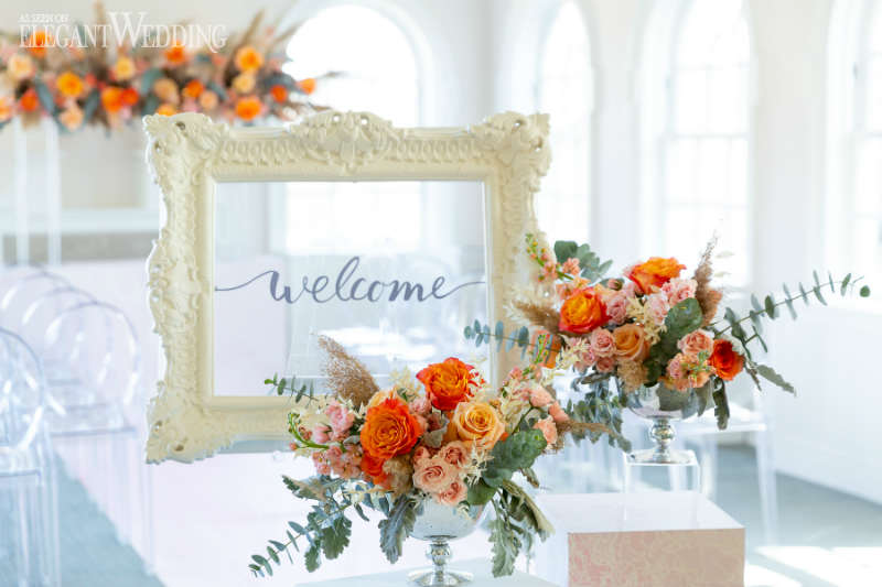 orange wedding welcome sign