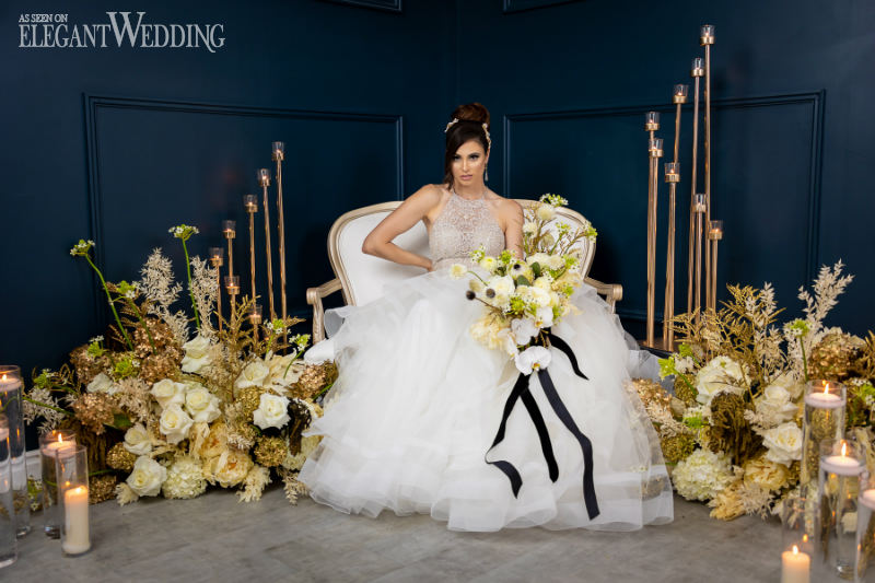 bride in a royal blue and gold wedding theme