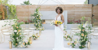 bride with a pretty yellow and white wedding ceremony